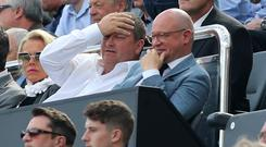 Newcastle owner Mike Ashley (centre) wants to sell the club by Christmas
