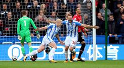 Huddersfield's Aaron Mooy celebrates scoring his side's first goal