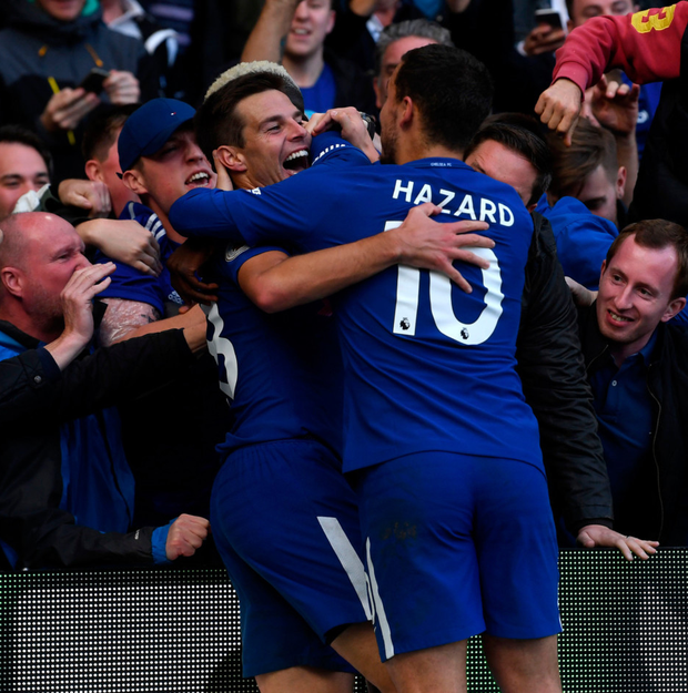 Cesar Azpilicueta (left) celebrates with Eden Hazard after scoring his side's third goal Photo: PA
