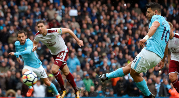 Manchester City's Sergio Aguero scores his side's first goal from the penalty spot, equalling Manchester City's all-time scoring record, during yesterday's Premier League win over Burnley at the Etihad Stadium. Photo: Martin Rickett/PA