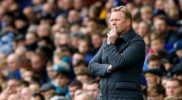 A 5-2 defeat to Arsenal at Goodison Park increased the pressure on Everton boss Ronald Koeman