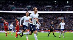 Tottenham's Harry Kane celebrates scoring his side's fourth goal of the game against Liverpool