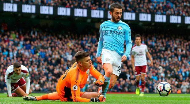 Nick Pope clips Bernardo Silva Photo: Getty