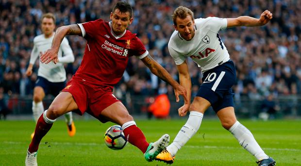 Liverpool's Dejan Lovren struggles to contain Tottenham's Harry Kane. Photo: AFP/Getty