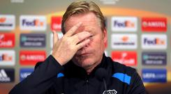Michael Keane (on the ground) says Everton's players have let Ronald Koeman down