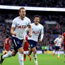 Harry Kane (left) scored twice against Liverpool on Sunday.