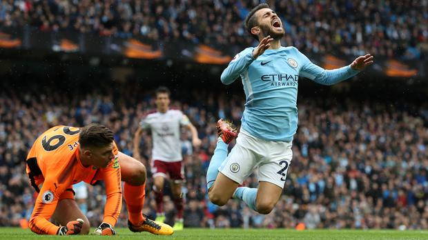 Bernardo Silva, right, won Manchester City a first-half penalty on Saturday