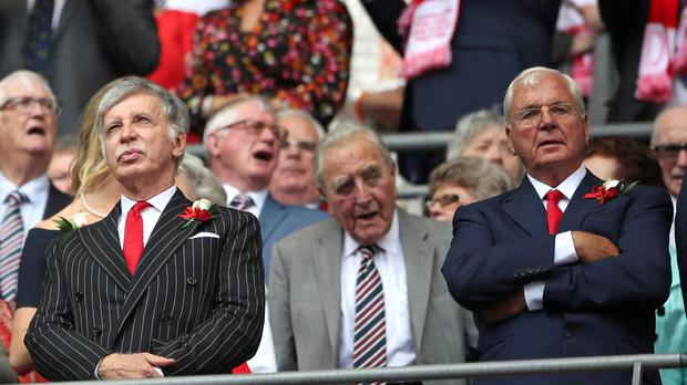 Arsenal majority shareholder Stan Kroenke, pictured left, and chairman Chip Keswick, right, are set to attend the club's AGM on Thursday