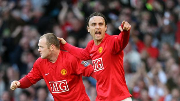 Wayne Rooney celebrates with team mate Dimitar Berbatov during the clash with Tottenham in April 2009