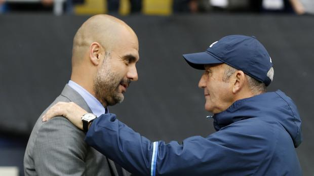 Tony Pulis, seen in his familiar baseball cap, will be reunited this weekend with Manchester City manager Pep Guardiola