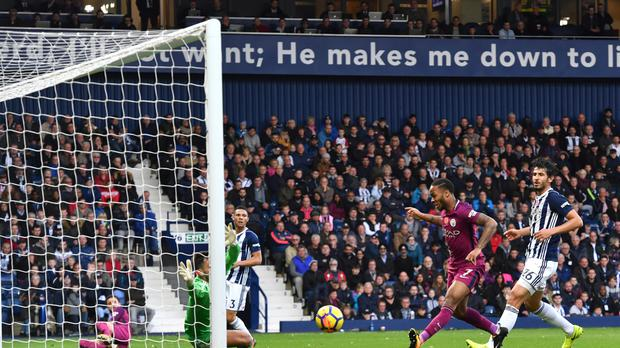 Raheem Sterling scores Manchester City's third goal in their 3-1 win at West Brom.