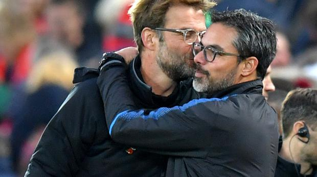 Liverpool manager Jurgen Klopp, left, got one over his best friend, the Huddersfield manager David Wagner with a 3-0 victory at Anfield
