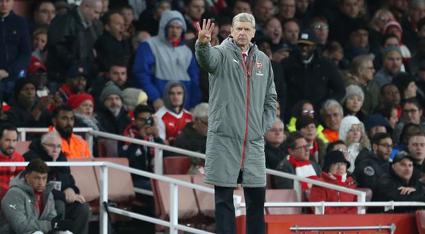 Arsenal manager Arsene Wenger gestures on the touchline during the Premier League match against Swansea