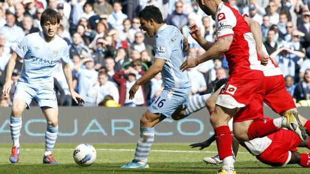 Sergio Aguero scores City's winning goal against QPR