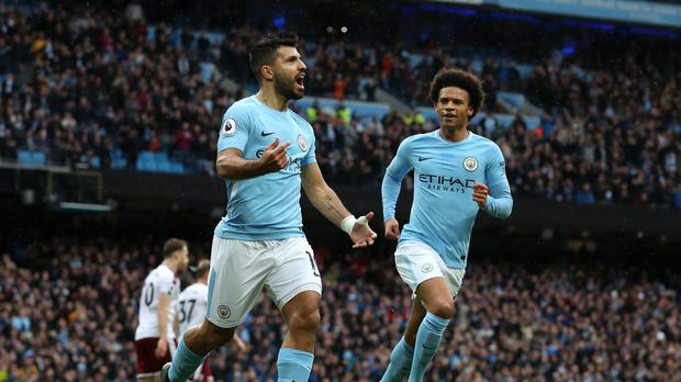 Sergio Aguero, left, is now Manchester City's all-time record scorer