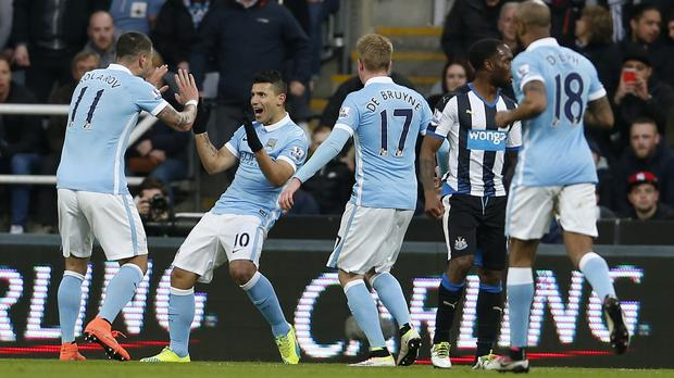 Sergio Aguero, second left, celebrated one of his 11 Premier League goals against Newcastle