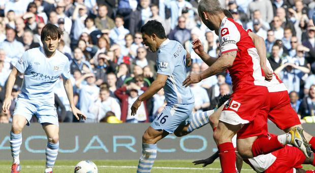 Sergio Aguero, centre, scored Manchester City's winning goal against QPR