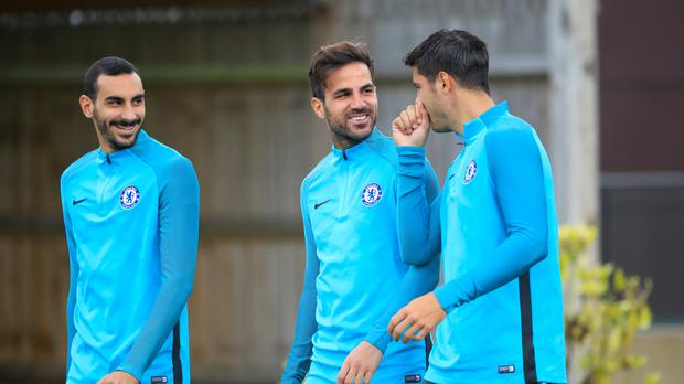 Chelsea midfielder Cesc Fabregas (centre) maintains there are no issues with the training regime of head coach Antonio Conte