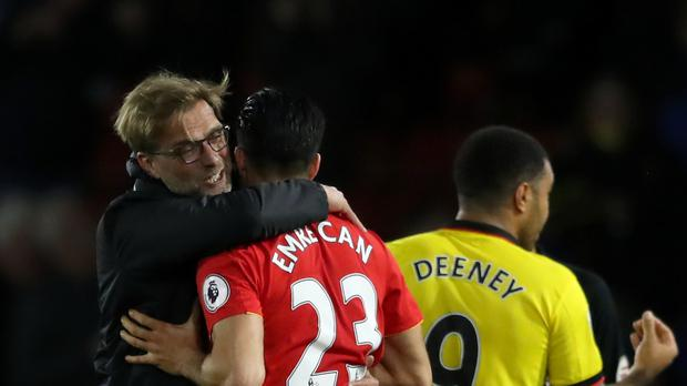 Jurgen Klopp, pictured left, insists he will not put pressure on Emre Can to sign a new contract