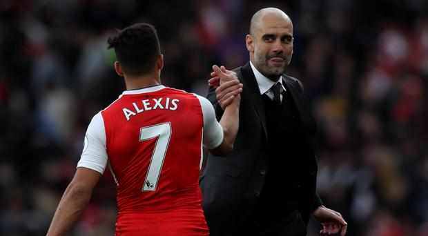 Manchester City manager Pep Guardiola (right) wanted to sign Arsenal's Alexis Sanchez