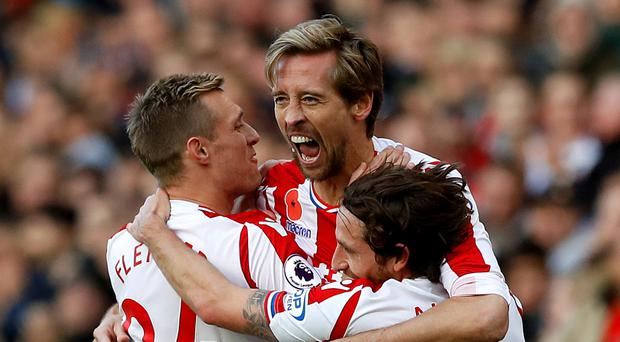 Peter Crouch, centre, celebrates scoring the equaliser