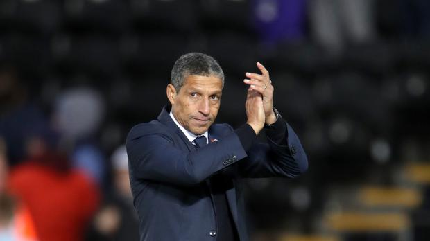 Brighton manager Chris Hughton celebrates his side's 1-0 Premier League win at Swansea