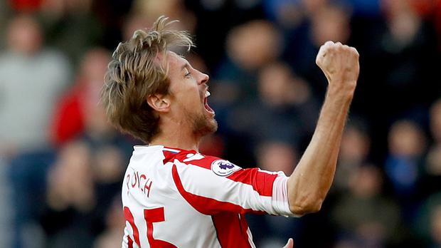 Peter Crouch celebrates his goal against Leicester