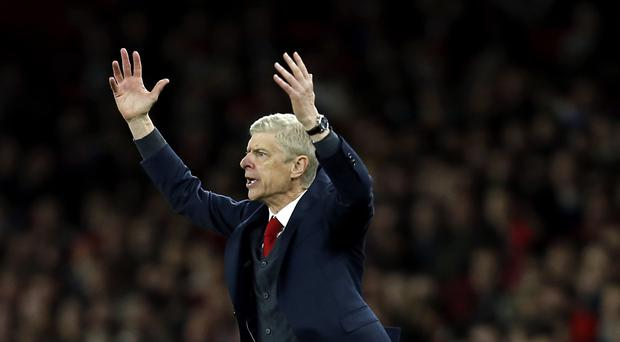 Arsene Wenger was not impressed with some of Michael Oliver's decisions
