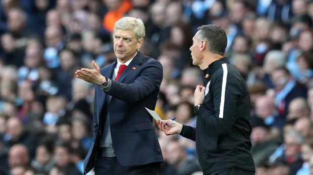Arsenal manager Arsene Wenger (left) said Raheem Sterling ''dives well'' following Manchester City's 3-1 Premier League victory at the Etihad Stadium on Sunday