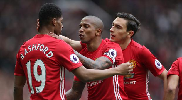 Ashley Young, centre, is impressed with Marcus Rashford's attitude