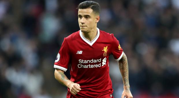 Liverpool playmaker Philippe Coutinho insists he is happy with life despite his failure to force a move to Barcelona in the summer