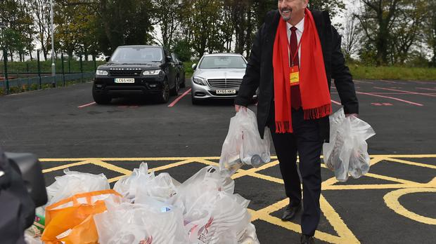 Handout photo dated 28/10/17 provided by Liverpool Football Club of Chief Executive Peter Moore donates to the club's match-day foodbank collection ahead of the Premier League match between Liverpool and Huddersfield Town at Anfield, Liverpool. PRESS ASSOCIATION Photo. Issue date: Monday November 13, 2017. See PA story SOCCER Liverpool Moore. Photo credit should read: Liverpool Football Club/PA Wire. NOTE TO EDITORS: This handout photo may only be used in for editorial reporting purposes for the contemporaneous illustration of events, things or the people in the image or facts mentioned in the caption. Reuse of the picture may require further permission from the copyright holder.