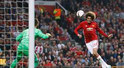 Marouane Fellaini, right, is wanted by Manchester United