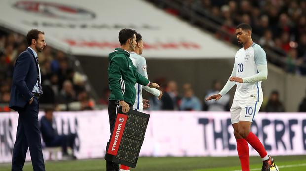 Ruben Loftus-Cheek (right) is remaining positive after a back problem forced him off during the first half of England's friendly against Brazil on Tuesday night