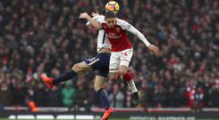 Hector Bellerin, right, and Ben Davies battle for the ball on Saturday
