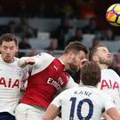 Shkodran Mustafi, in the red of Arsenal, wins a header to give his side the lead against Tottenham