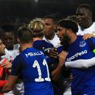 Everton's Ashley Williams clashed with Lyon's Anthony Lopes before a fan took a swing at the goalkeeper