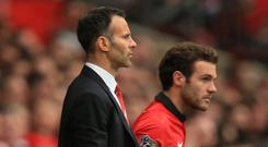 Juan Mata, right, would like to play on like Ryan Giggs, left