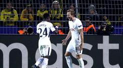 Harry Kane, right, has helped Spurs qualify for the Champions League knockout stages