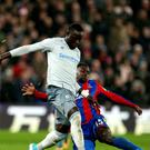 Everton striker Oumar Niasse, left, is said to have 'deceived the referee' when winning a penalty against Crystal Palace