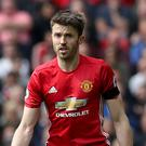 Michael Carrick is aiming to make a swift return to action after undergoing treatment for an irregular heart rhythm