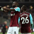 West Ham United's Cheikhou Kouyate (left) celebrates scoring his side's first goal of the game during the Premier League match at the London Stadium.