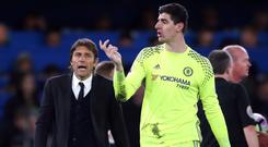 Head coach Antonio Conte, left, says Chelsea have the best goalkeeper in the world in Thibaut Courtois, right,
