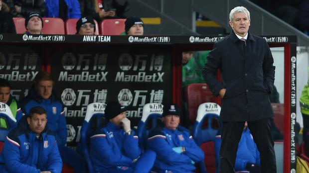 Stoke boss Mark Hughes expects his side to climb into the top half soon