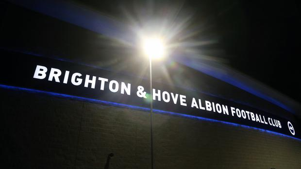 Two stewards were sent to hospital after incidents outside Brighton's ground