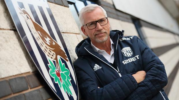 Handout photo dated 29/11/2017 provided by West Bromwich Albion FC/AMA of West Bromwich Albion unveiling their new manager Alan Pardew at the club's PALM training ground.