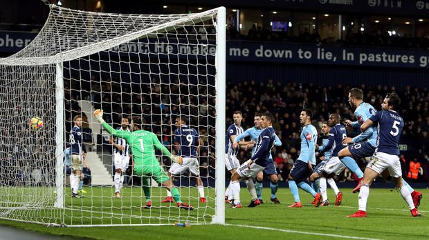 Jonny Evans' own goal gave Newcastle a 2-2 draw at West Brom on Tuesday.