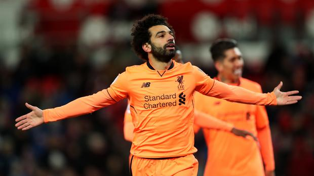 Liverpool's Mohamed Salah celebrates scoring the second goal against Stoke