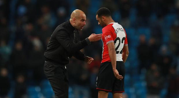 Manchester City's Pep Guardiola had words with Southampton's Nathan Redmond