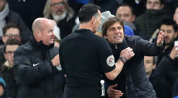 Antonio Conte, right, has accepted an FA charge over his row with referee Neil Swarbrick